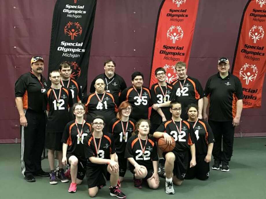 Area 24 Special Olympics teams went to the state basketball tournament on March 25 at Calvin College. Team A24 Black won first place. Pictured (front row, kneeling, from left to right) are Katie Shilander, Bailee Gerych, Aja Shilander, Emma Tyndall, Rolando Dila and Mercedes Segura; (second row) Coach Duane Tyndall, Cody Ashbrook, Erik Boerema, Cristofer Lopez Gustavo Sheeley, Ryan Hobart and Coach Doug Hobart; (back row) Joey Tyndall and Coach Cliff Shilander. (Courtesy photo)