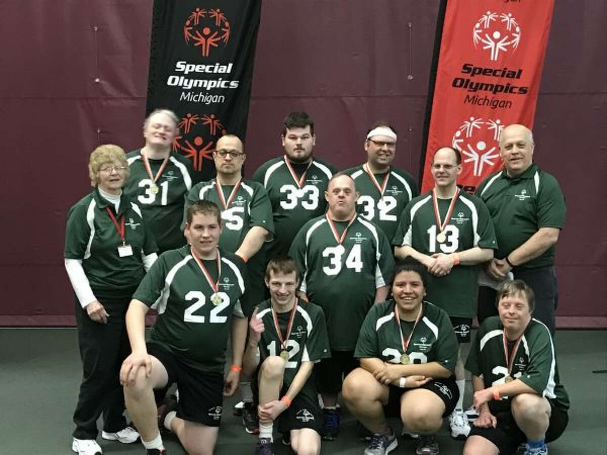 Area 24 Special Olympics teams went to the state basketball tournament on March 25 at Calvin College. Team A24 Green took home gold. Pictured (front row, left to right) are Brandon Kelley, Dakota Wallager, Lupe Covarrubias, Cary Dodson; (middle row) Coach Alie VanderHaag, Alfred Finner, James Treml, Mike Witkowski; and (back row) Paul Lefler, Tom England, Justin DeVrie and Coach Grant Griswold. (Courtesy photo)