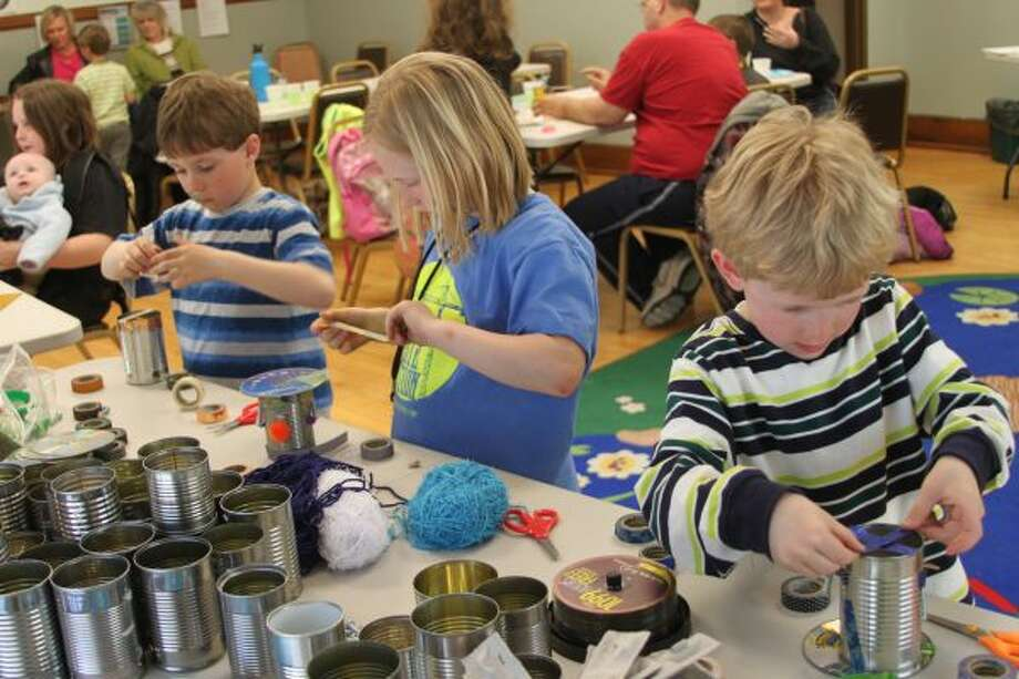 """Children converted """"trash to treasure"""" on Saturday as part of the Manistee County Library's Earth Day program. (Photos by Michelle Graves/News Advocate)"""