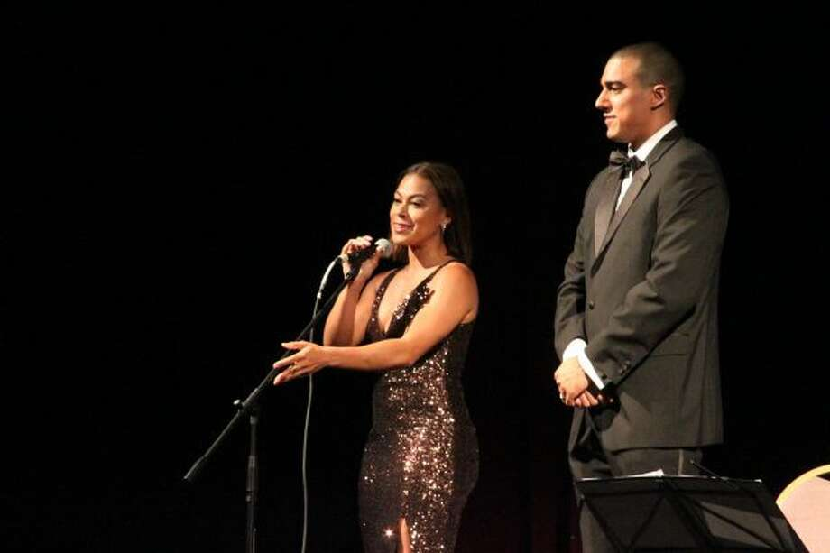Manistee native Toni Trucks and Xavier Verna, RRCA executive director, give a special announcement to attendees of a past gala at the Ramsdell Theatre. (Ashlyn Korienek/News Advocate)
