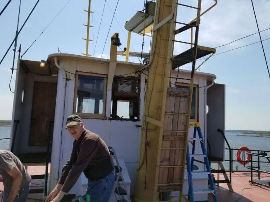 Rotted windows in the forward pilot house of the SS City of Milwaukee were replaced by members of the Century Boat Club on Friday. (Courtesy photo)