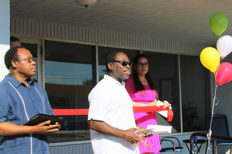 Manistee's Christian Faith Church Int'l held a dedication ceremony for its new church building on Saturday at 55 Division St. Bishop Emmanuel Botwey from Ghana, Africa, and Pastor Joseph Baffour from Chicago, were in attendance. (Ashlyn Korienek/News Advocate)