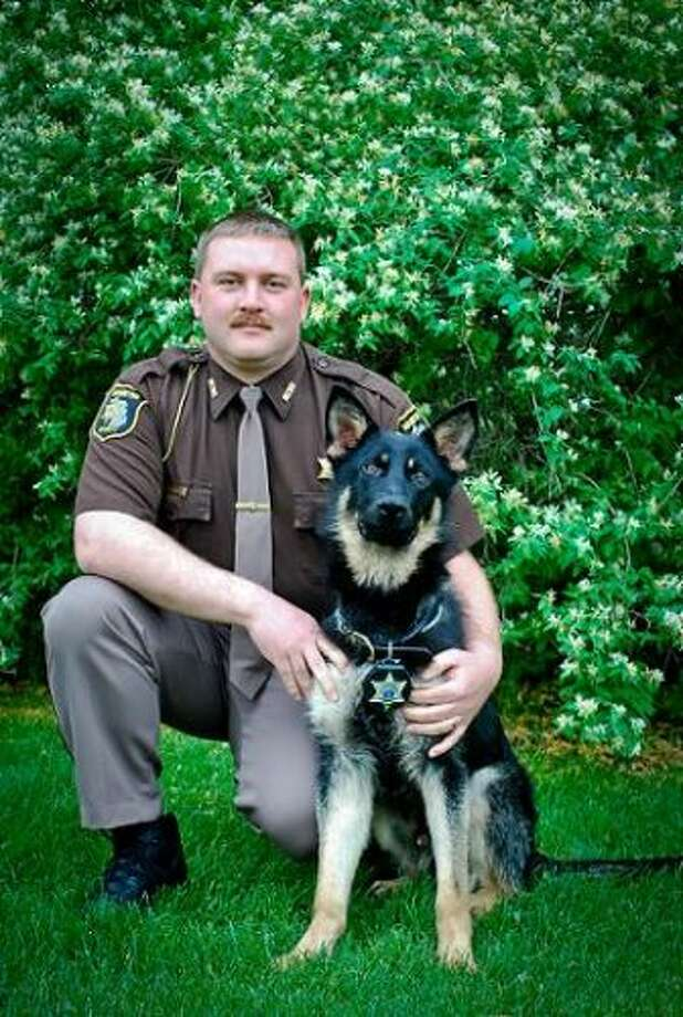 Sgt. Jason Torrey and Benco, nearly seven years ago, when the two completed training for the Manistee County Sheriff's Office. (Courtesy Photo/Jason Torrey)