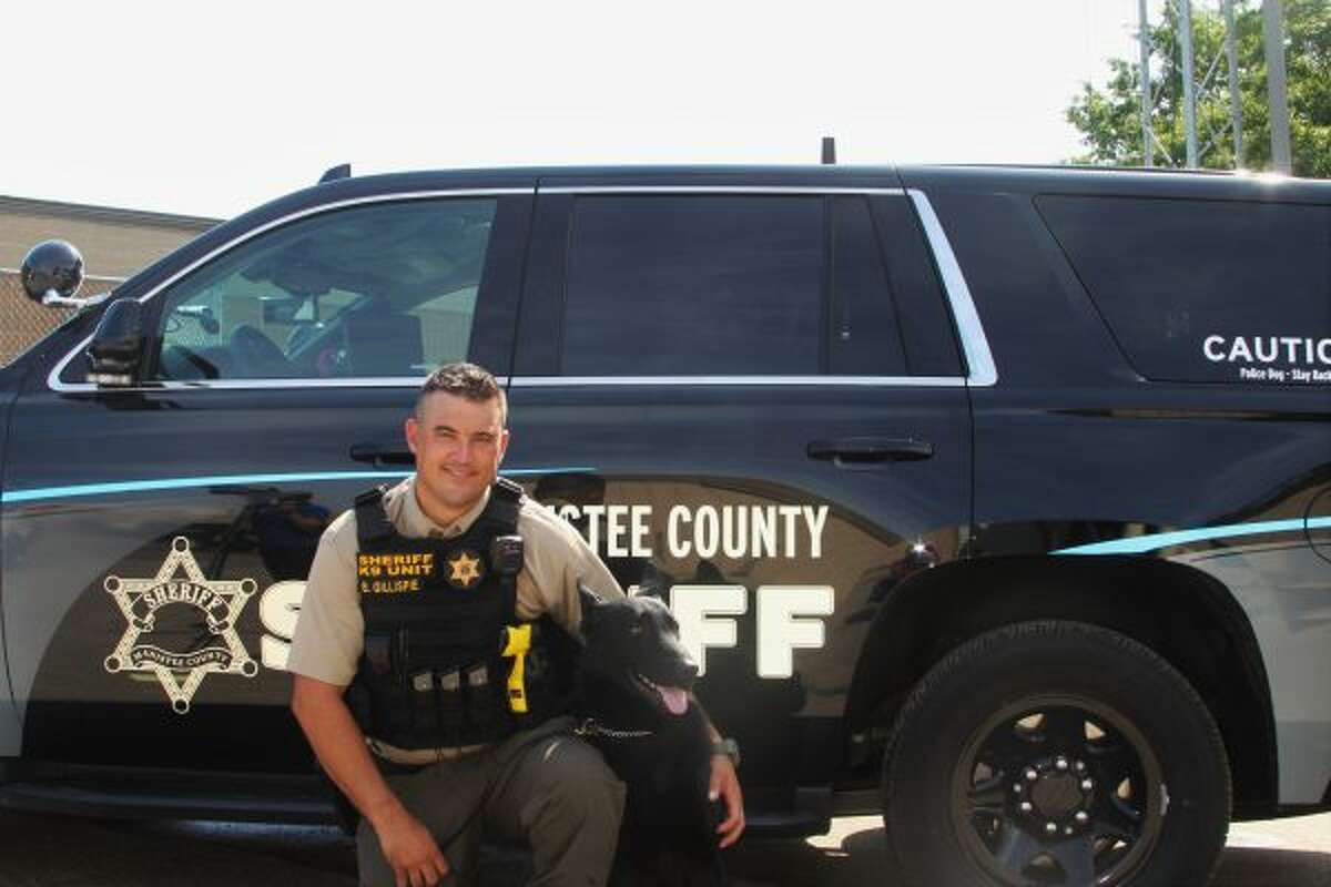 Deputy Brandon Gillispie and Beno, the new K-9 on duty, pose in front of their new police vehicle, which was recently purchased and upgraded to suit Beno's needs. (Ashlyn Korienek/News Advocate)