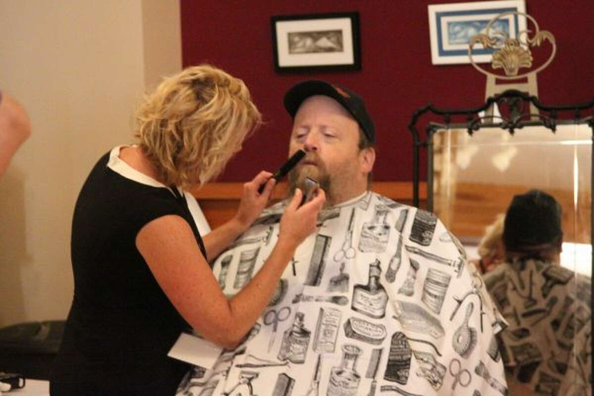 Jamie Catlett, with Manistee Men's Grooming Company, was named the winner of this year's Spark Manistee event. During the finale, she gave haircuts to men in attendance to show off her talents. (Ashlyn Korienek/News Advocate)