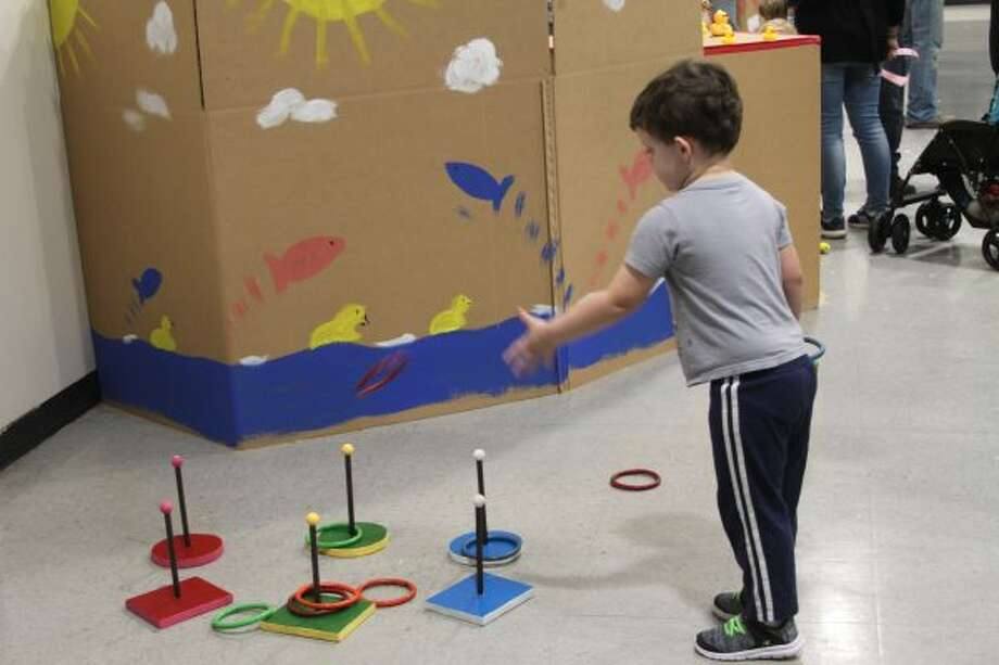 The ring toss game was popular among many smaller children on Saturday at the Kids Carnival, hosted by the Civic Club, at Stronach Township Hall. (Michelle Graves/News Advocate)