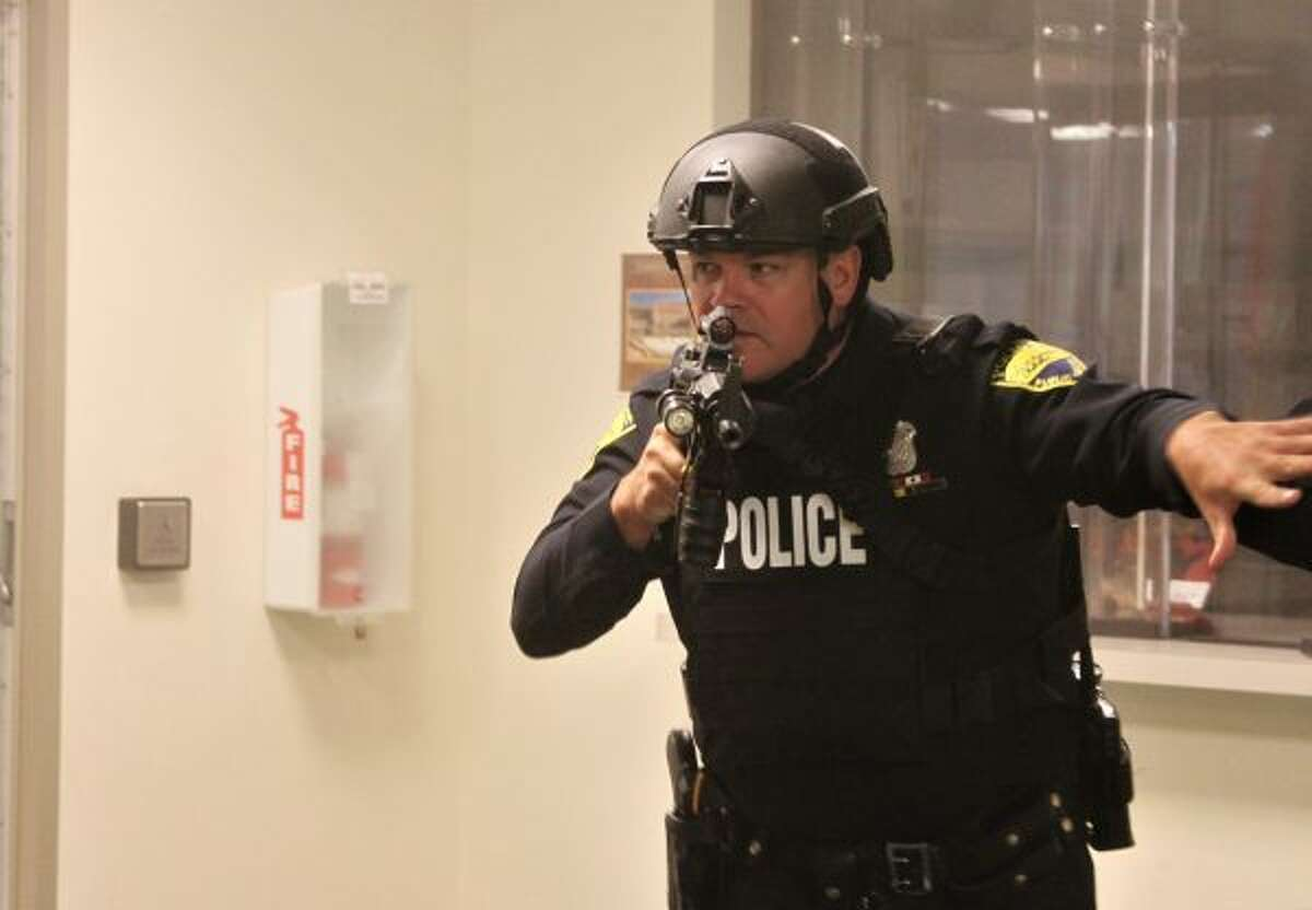 Police search the Manistee County Courthouse as part of a drill. (Ashlyn Korienek/News Advocate)