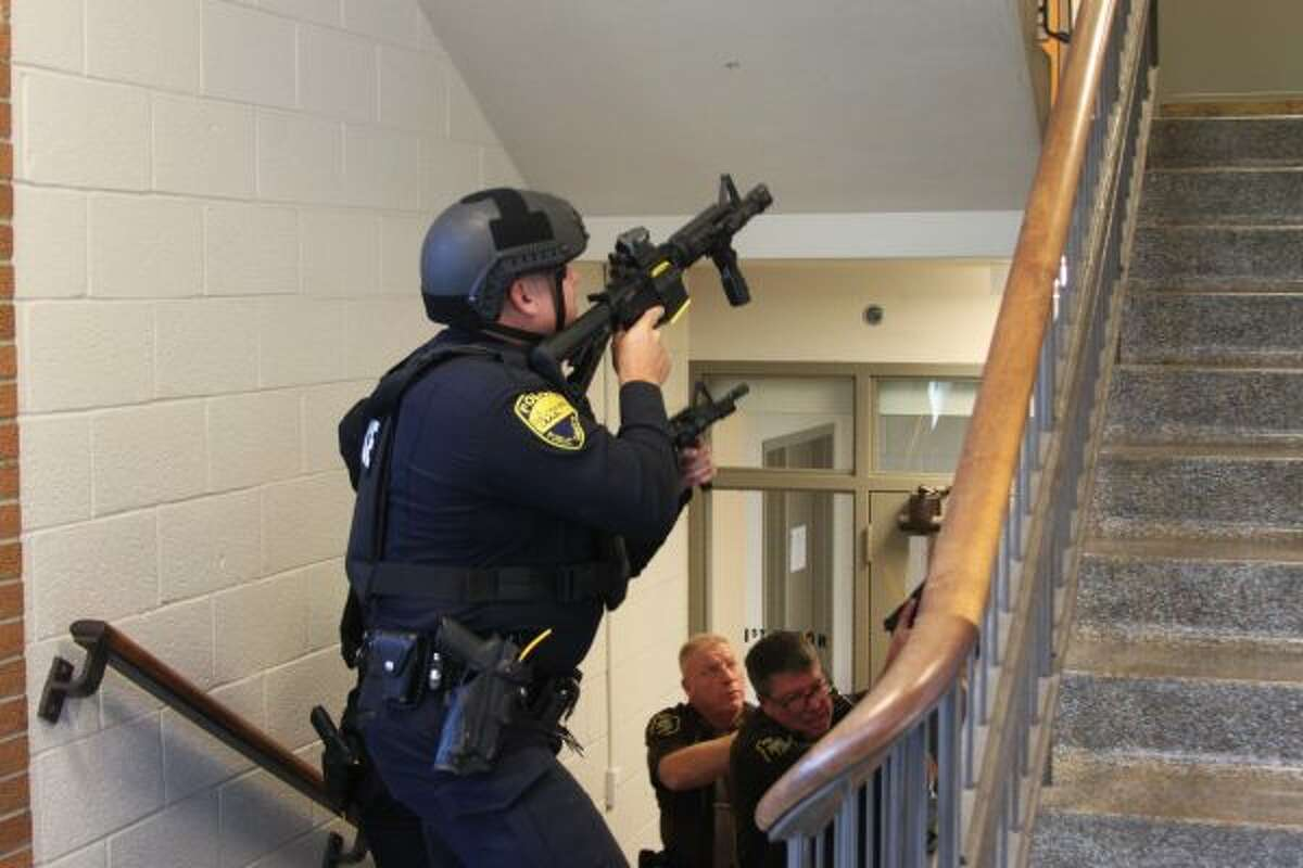 Police enter the stairway of the courthouse, checking the second floor for any victims or suspects. Then, they cleared the area. (Ashlyn Korienek/News Advocate)