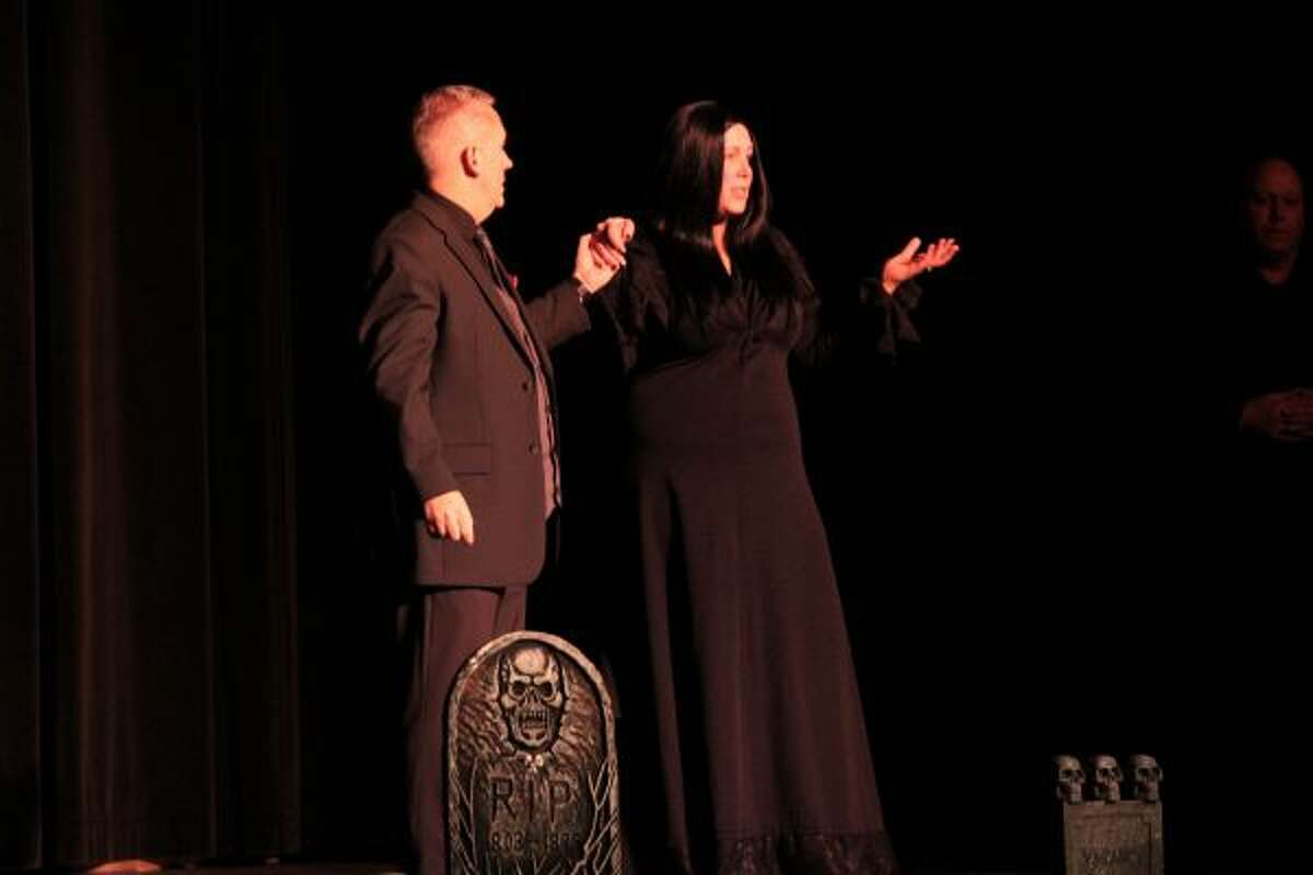 """Amanda Feyen, as Morticia, and Ben Hengy, as Gomez, in the upcoming """"The Addams Family"""" production. (Ashlyn Korienek/News Advocate)"""