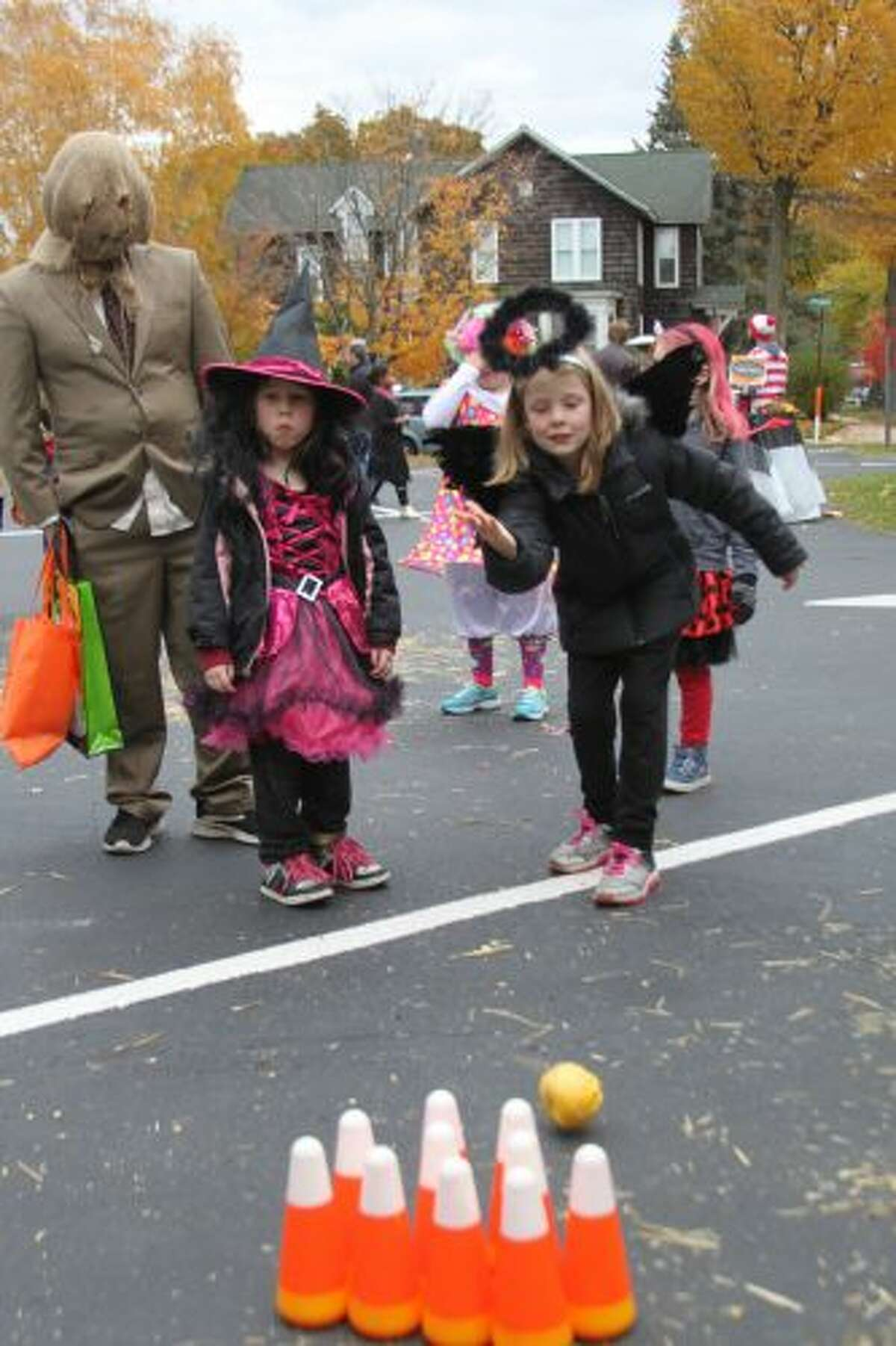 Children played games, such as pumpkin bowling, on Saturday during Manistee United Methodist Church's block party. (Michelle Graves/News Advocate)