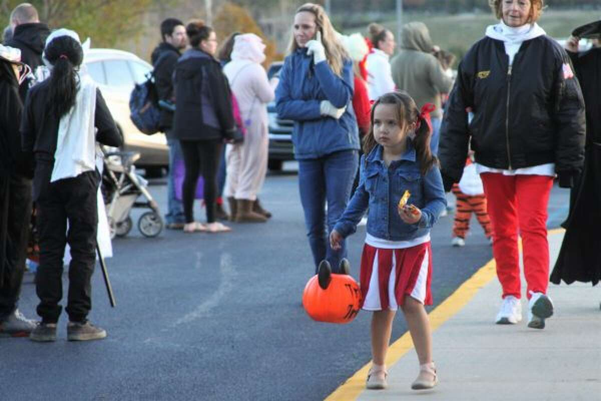 """A girl trick or treats at the Faith Covenant Church """"Trunk or Treat"""" event on Wednesday. (Ashlyn Korienek/News Advocate)"""
