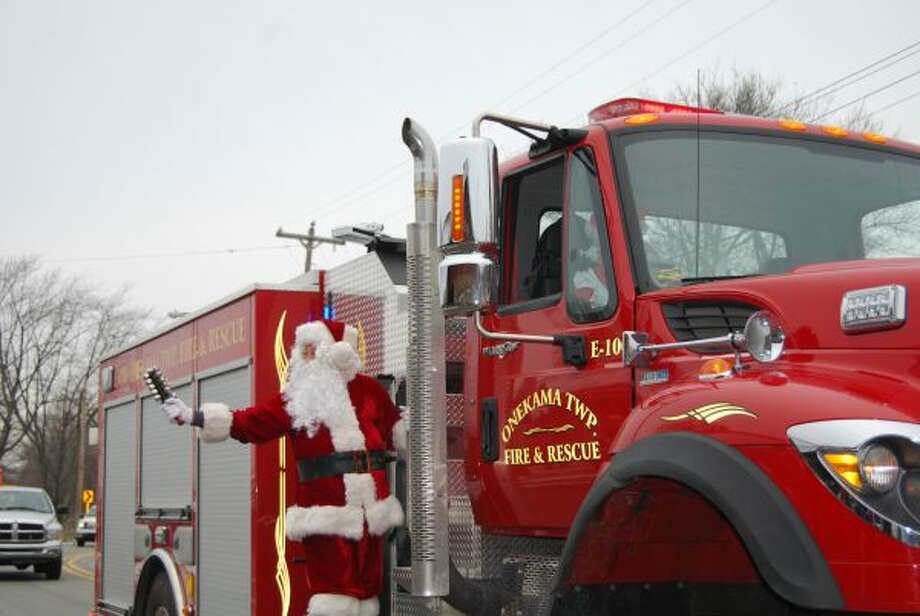 Santa arrives at the Farr Center in Onekama via fire truck, courtesy of the Onekama Fire Department. (Courtesy photo)