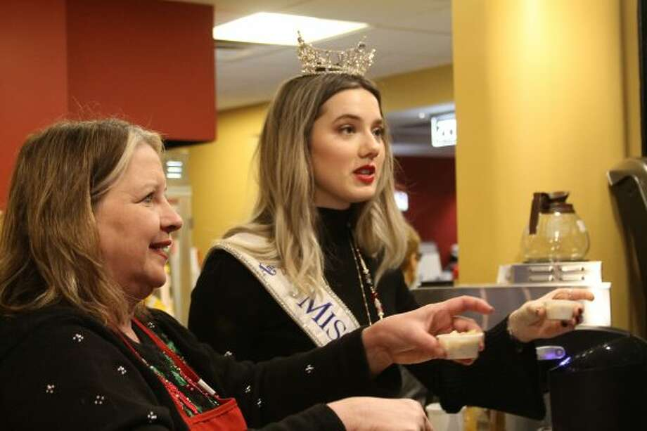 Miss Michigan 2018, Emily Sioma, of Grass Lake, helped volunteers at the Vogue serve soup to the public. (Ashlyn Korienek/News Advocate)