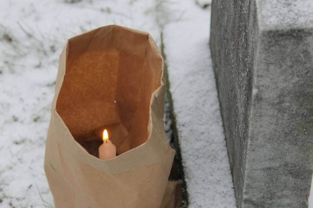 Volunteers placed 1,000 luminaries on graves at Maple Grove Cemetery in Kaleva on Friday evening. (Jane Bond/News Advocate)