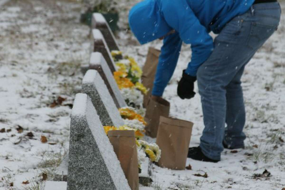 Since 1998, Kaleva celebrates the Finnish tradition of lighting candles for those who have passed by placing luminaries next to each grave in the Maple Grove Township cemetery. (Jane Bond/News Advocate)