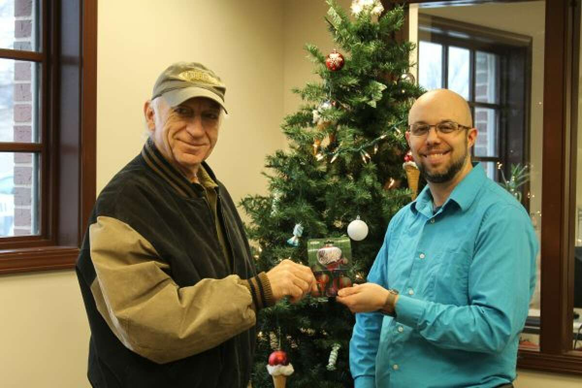 Manistee News Advocate circulation manager Aaron DeKuiper (right) presents Bruce Patulski with a $300 Meijer gift card. Patulski won first prize in the Manistee News Advocate's Grocery Giveaway contest. (Jane Bond/News Advocate)