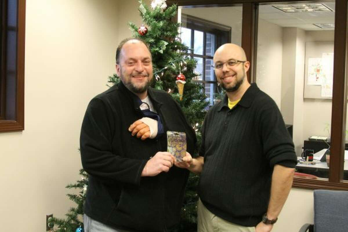 Manistee News Advocate circulation manager Aaron DeKuiper (right) presents Tom Snay with a $200 Meijer gift card. Snay won the second prize in the Manistee News Advocate's Grocery Giveaway contest. (Jane Bond/News Advocate)