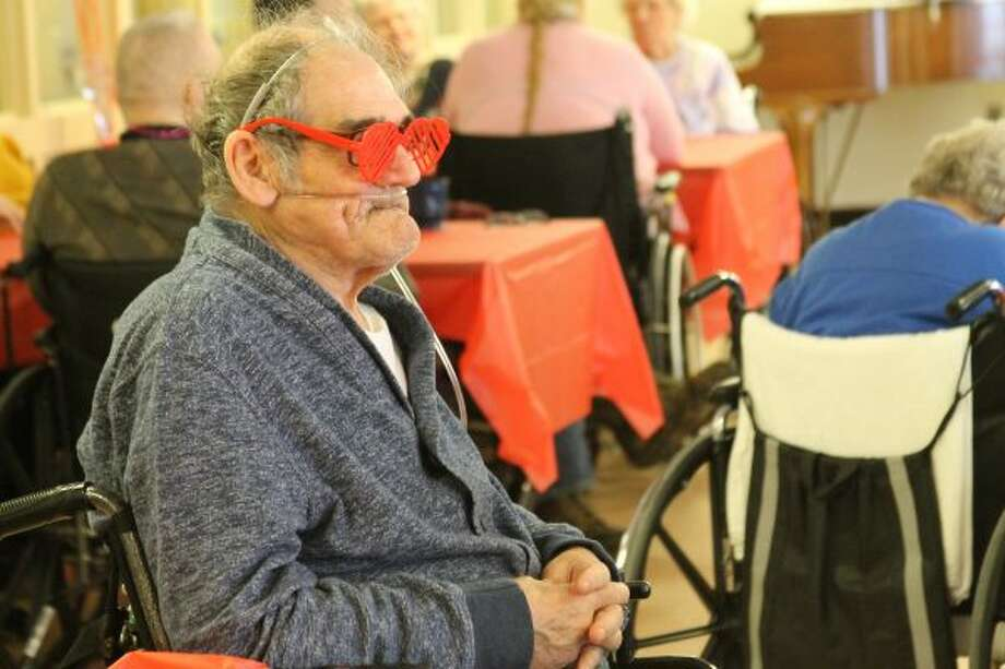 Dennis Helferich sports some festive eye wear on Wednesday during the Manistee County Medical Care Facility's Valentine's Day Party. (Michelle Graves/News Advocate) CLICK THROUGH FOR GALLERY