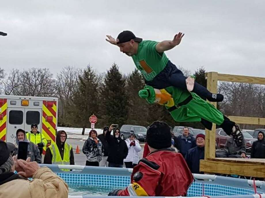 The Manistee Polar Plunge was held on Saturday, with over 40 participants — many dressed in St. Patrick's Day themed costumes — braving the cold water. (Jane Bond/News Advocate)
