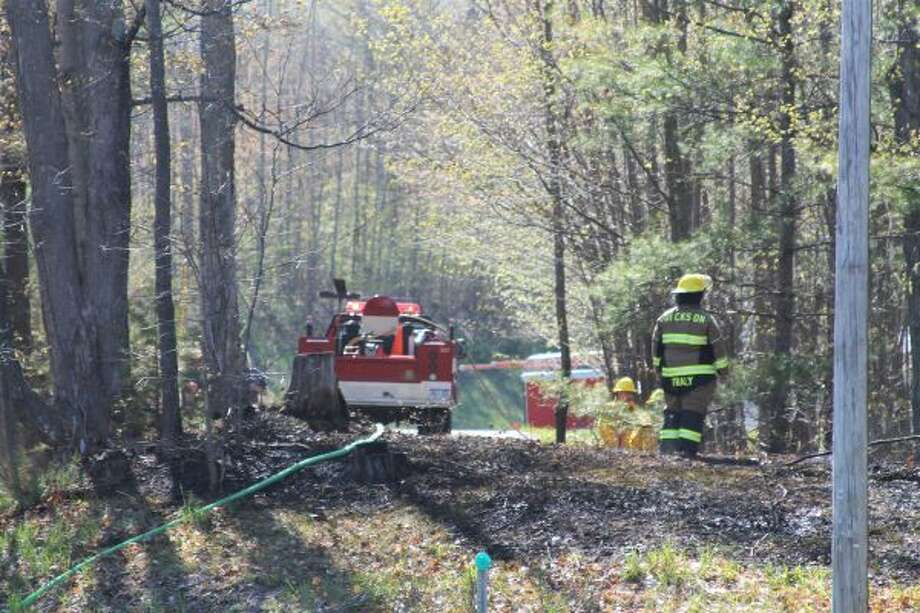 A brush fire was reported at Chippewa Highway near Schoedel Road in Manistee Township. (Ashlyn Korienek/News Advocate)
