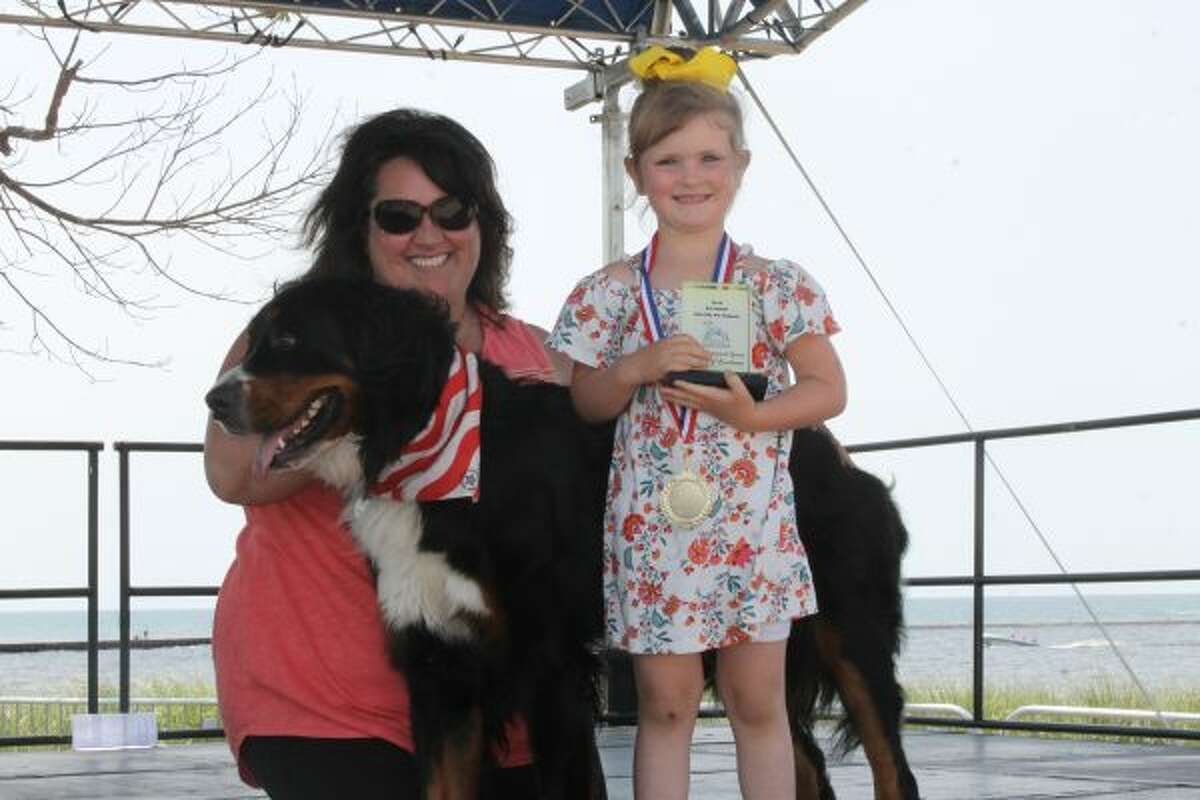Natalie and Molly with Chewy won the Best in Show Blue Bytwork Spirit Award of Excellence on Sunday during the Port City Pet Pageant during the Manistee National Forest Festival. (Michelle Graves/News Advocate) ***CLICK ON PHOTO FOR MORE PHOTOS***