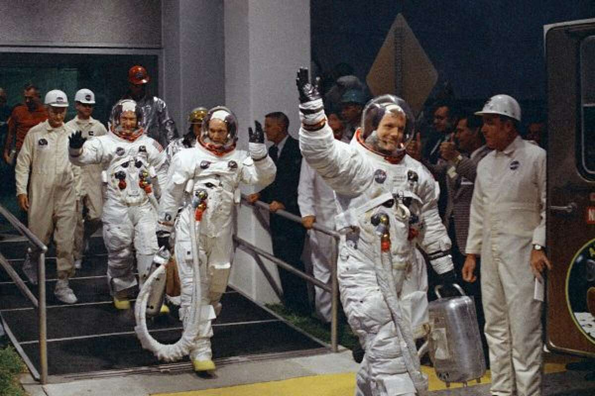 In this July 16, 1969 file photo, from right, Neil Armstrong, Michael Collins and Buzz Aldrin walk to the van that will take the crew to the launchpad at Kennedy Space Center on Merritt Island, Florida. (AP Photo/File) ***CLICK FOR MORE PHOTOS****