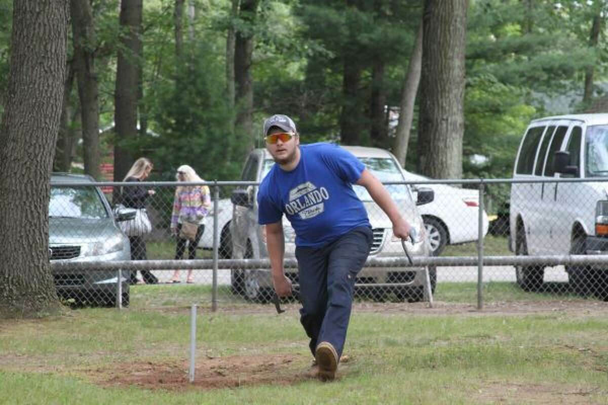 Cameron Granville warms up before the horseshoe throwing competition, one of several sporting events at Brethren Days in 2019. (Scott Fraley/News Advocate)