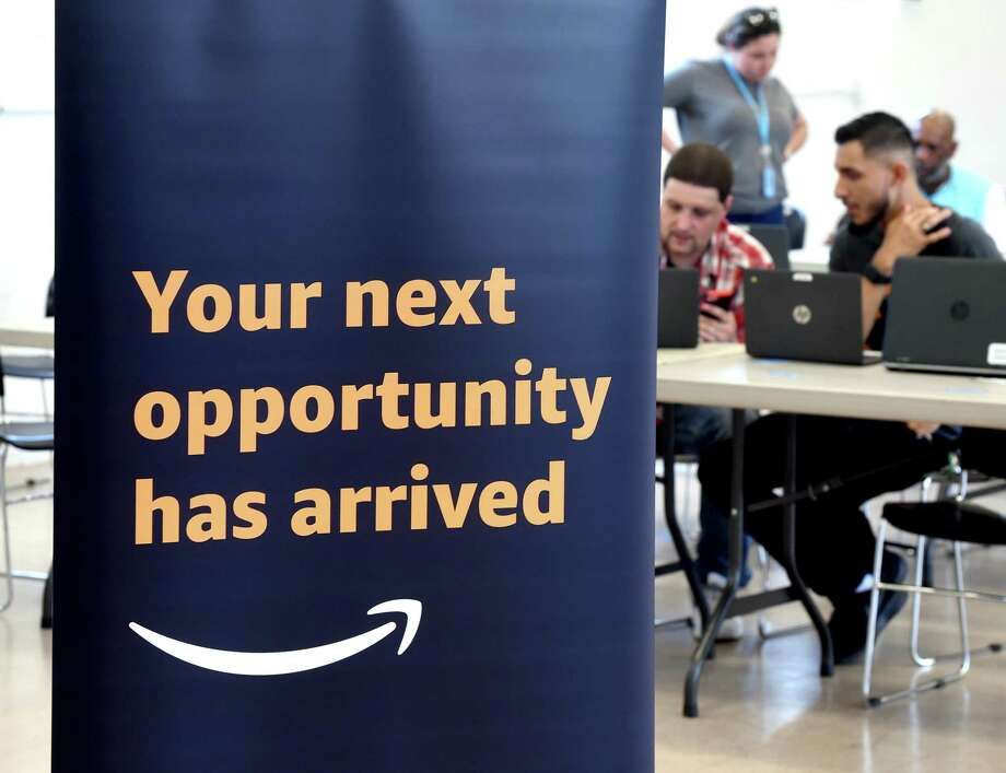 A New Haven resident gets assistance in July 2019 at an Amazon job fair in Hamden, to fill available slots for a fulfillment center in North Haven that will employ 1,800 people. New Haven and East Haven generated the biggest economic momentum last year for large and small cities in Connecticut, according to an October index published by the state Department of Labor. Photo: Arnold Gold / Hearst Connecticut Media / New Haven Register