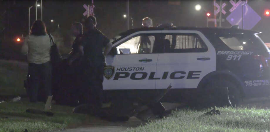 An off-duty police officer was nearly run down by a woman who had a 2-month old infant in her vehicle and fired his gun, as she attempted flee a car crash in south Houston. Photo: OnScene.TV