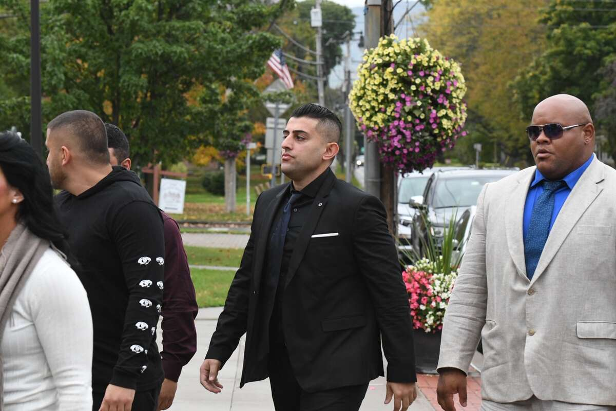 Nauman Hussain, 29, the operator of the limousine company involved in the Oct. 6 crash that killed 20 people, arrives in Schoharie County Court Wednesday for a pre-trial conference.