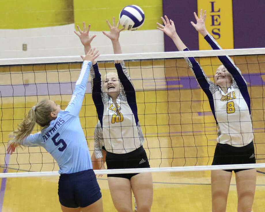 Jersey's Clare Breden (5) gets tools the block of CM's Sydney Henke (8) and Claire Christeson during the second set of the Eagles' two-set Mississippi Valley Conference volleyball victory Tuesday night in Bethalto. Photo: Greg Shashack / The Telegraph