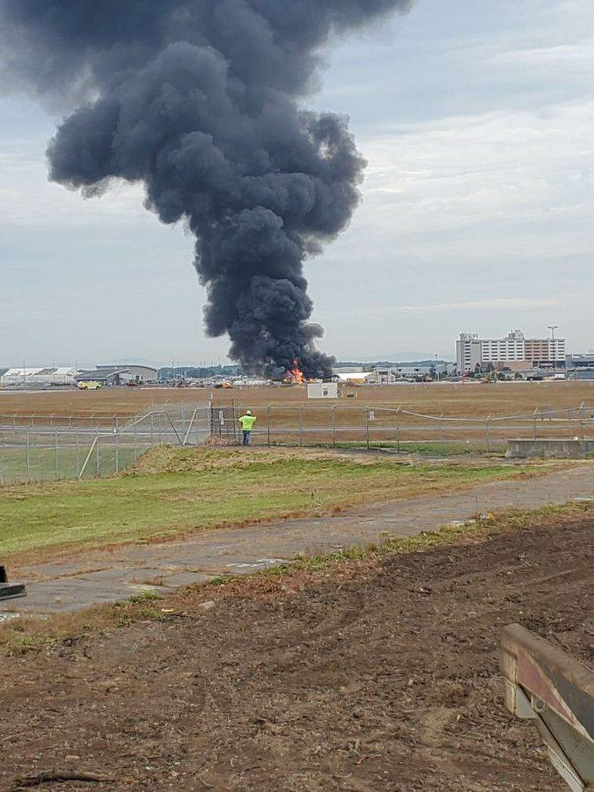 Firefighters are responding to a fire at Bradley International Airport involving an aircraft.