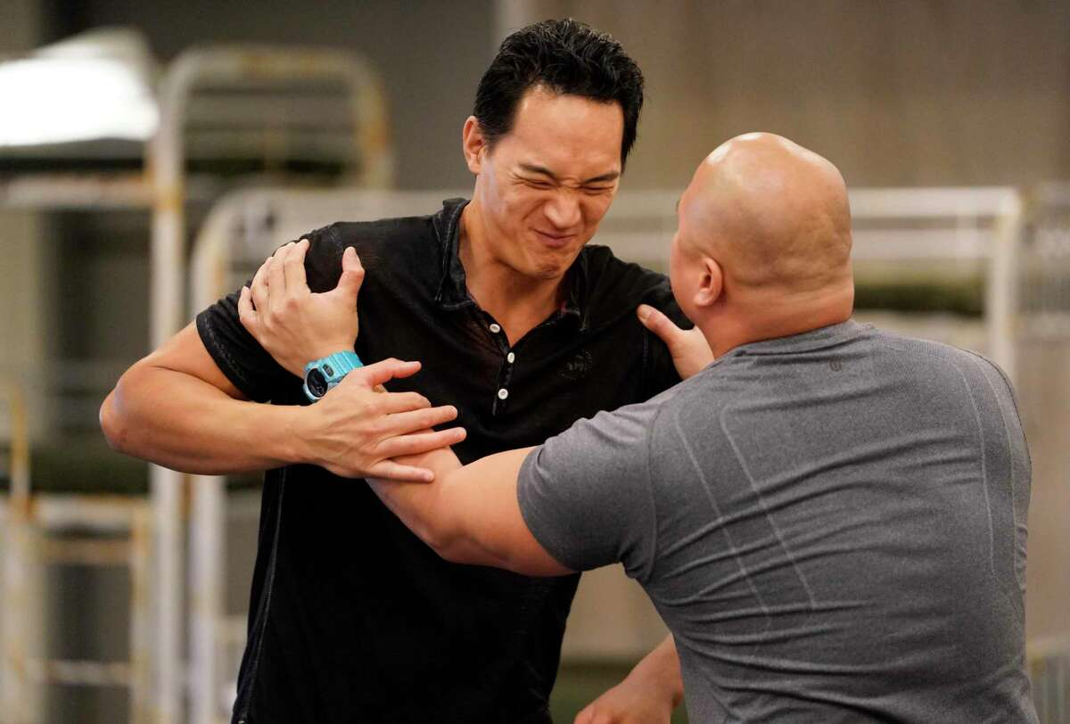 Edward Chin-Lyn, left, who plays Quang, and Viet Vo, right, who plays Nhan, rehearse