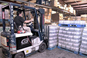 An employee at the Laredo ISD Department of Operations uses a forklift to unload 24 pallets of water, Monday, September 30, 2019, that will be distributed to schools within the affect area of the boil water alert issued by TCEQ and City officials over the weekend. The water was supplied by TCEQ.
