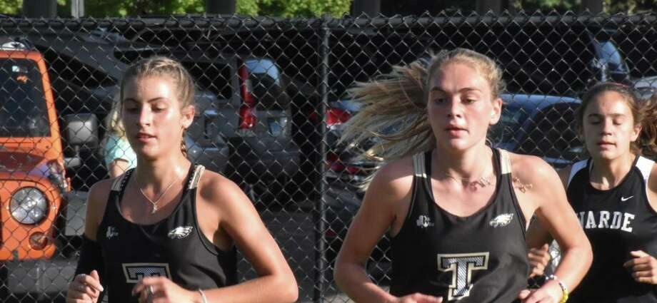 Seniors Alessandra Zaffina and Emily Alexandru both had top-five finishes to lead the Eagles to two victories on Tuesday. Photo: Contributed Photo / Trumbull High Athletics / Trumbull Times