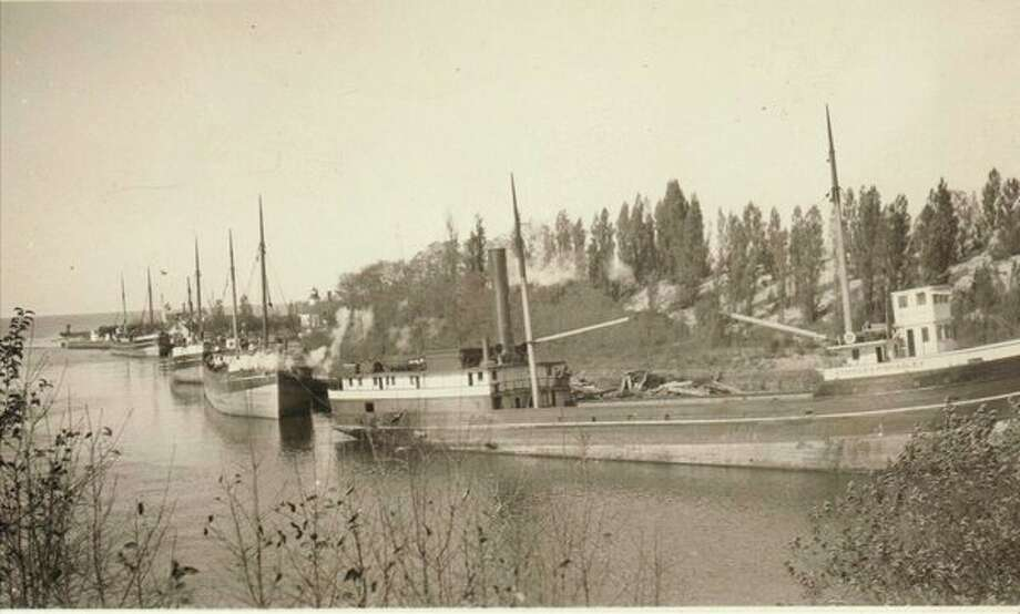 Ships line the Manistee River Channel in this 1890s photograph waiting to take loads of lumber to ports of call around the Great Lakes.
