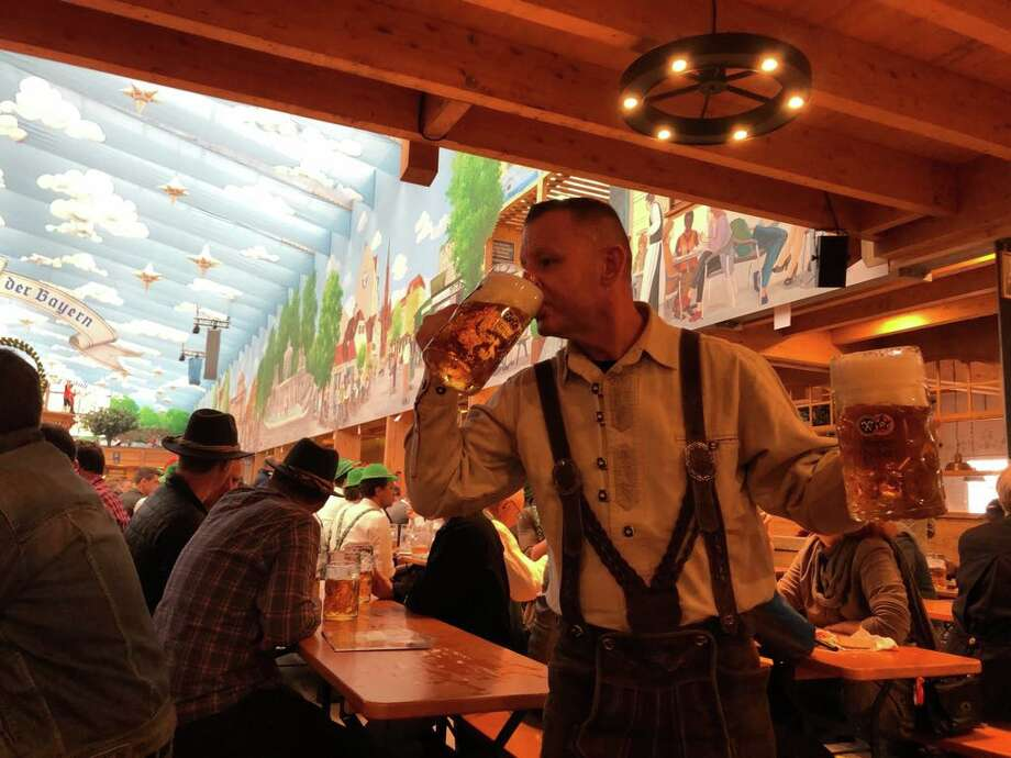 Former San Antonian Jeffrey Kirk downs a cold one during Oktoberfest in Munich, Germany. Keep clicking for all the other places to celebrate beer in Seattle. Photo: Courtesy, Jeffrey Kirk