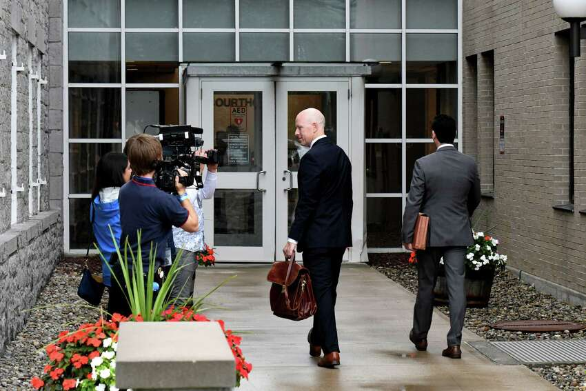 Lee Kindlon, center, attorney for Nauman Hussain, enters Schoharie County Court for an appearance on Wednesday, Oct. 2, 2019, in Schoharie, N.Y. (Will Waldron/Times Union)