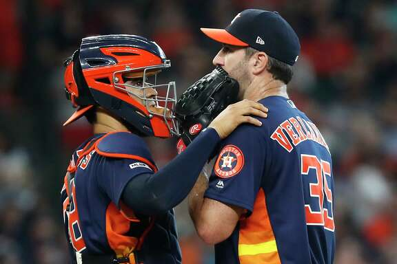 When Robinson Chirinos vists Justin Verlander on the mound, shown here against Boston, it starts with a calming hand on the shoulder and hidden conversatoin behind gloves and masks.