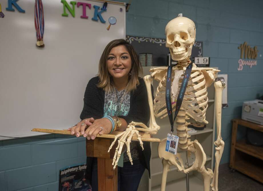 Bernadette Barragan in her classroom with a skeleton on Monday, August 12, 2019 at George H.W. Bush New Tech Odessa. Photo: Jacy Lewis/191 News