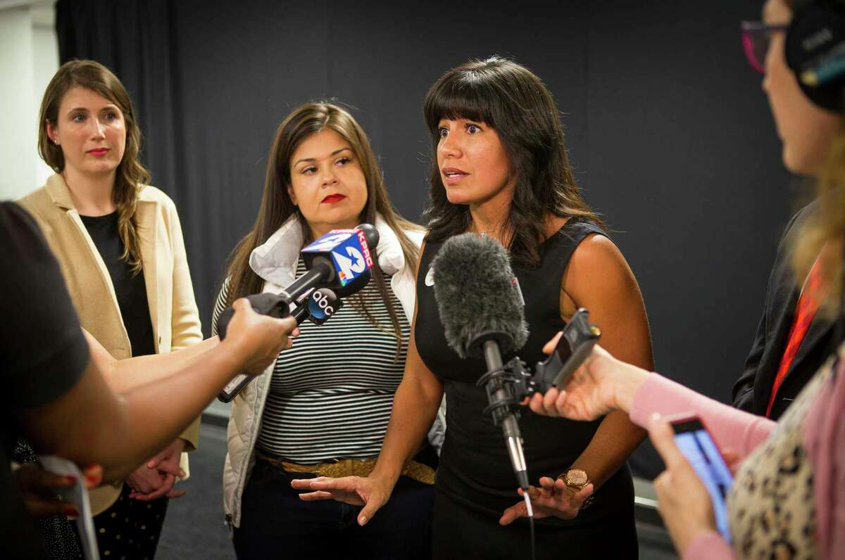 In this March file photo, Houston ISD Board President Diana Dávila (center) is joined by board members Elizabeth Santos, Holly Maria Flynn Vilaseca and Sergio Lira talk with reporters regarding the suspension of the district's superintendent search at Talento Bilingue De Houston. Dávila, Lira and Santos voted in favor of the district's lawsuit against the Texas Education Agency to stop state intervention in the district.