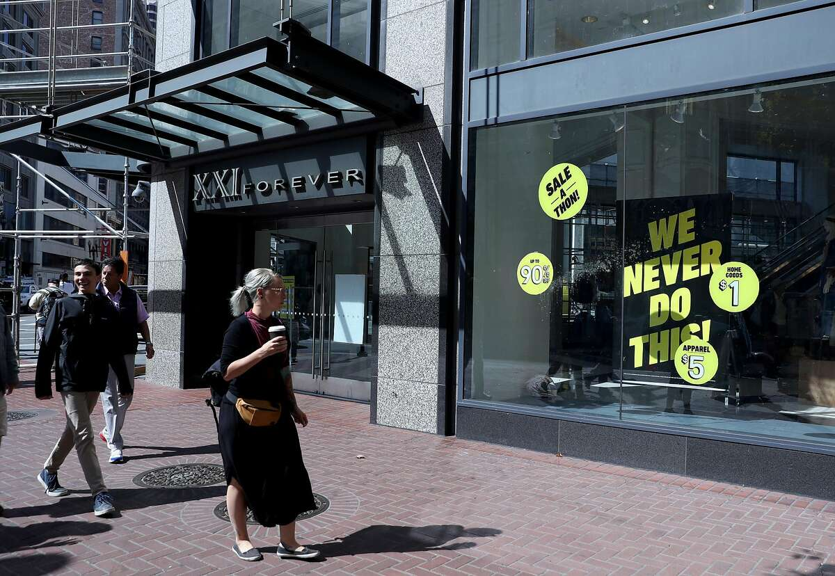 SAN FRANCISCO, CALIFORNIA - SEPTEMBER 30: Pedestrians walk by a Forever 21 store on September 30, 2019 in San Francisco, California. Retailer Forever 21 announced that they have filed for Chapter 11 bankruptcy protection and will close up to 178 of its stores in the United States. (Photo by Justin Sullivan/Getty Images)