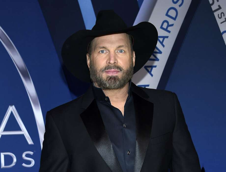 """FILE - This Nov. 8, 2017 file photo shows Garth Brooks at the 51st annual CMA Awards in Nashville, Tenn. Brooks, whose hits include """"Friends in Low Places,"""" and """"The Thunder Rolls,"""" will receive the Library of Congress Gershwin Prize for Popular Song in March 2020. (Photo by Evan Agostini/Invision/AP, File) Photo: Evan Agostini, Associated Press"""