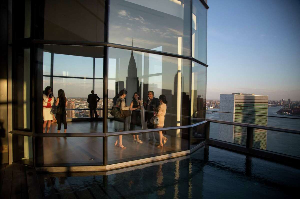Guests attend a pool party in a Manhattan penthouse in 2016.