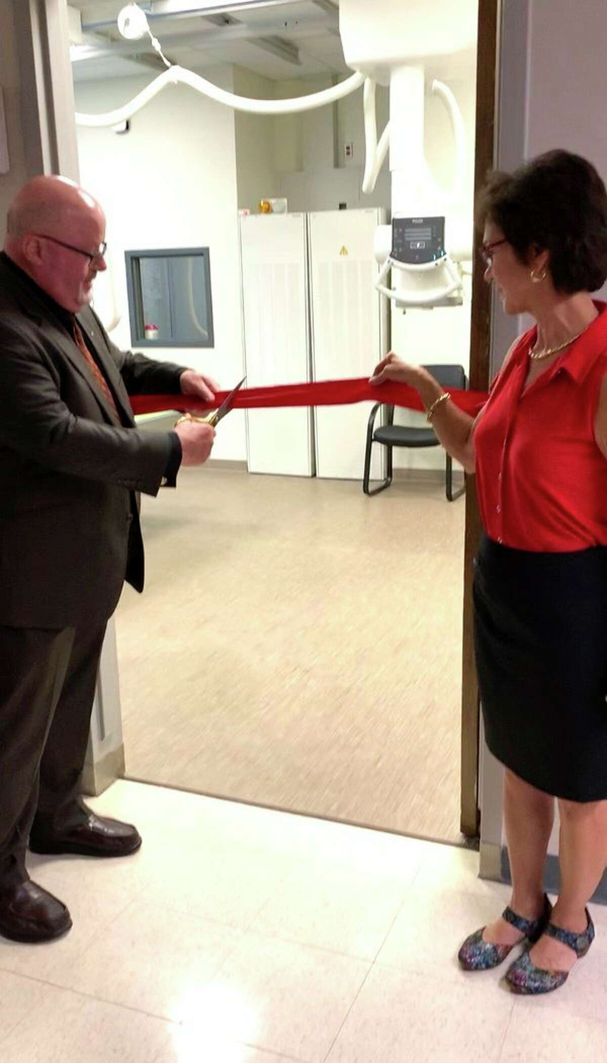 As a crowd of community members watched, John Hunt, board chairman, and Tami Salens, finance chair, cut the ribbon and invited everyone to tour the new x-ray room. (Submitted Photo)