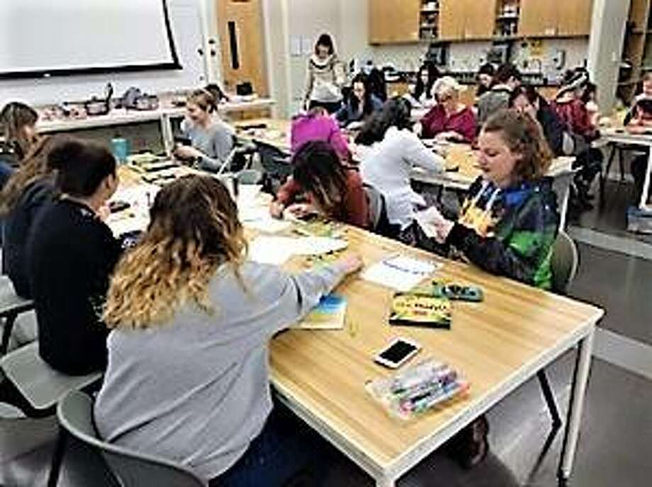 Students at a Southern Illinois University Edwardsville art therapy class learn how art can help with counseling.