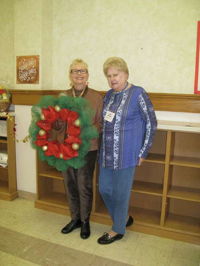 Torrington Woman's Club members show their custom wreath for the 2018 Festival of Trees, an event benefiting LARC and held at Valerie Manor. This year, LARC has chosen to change the event name to Night of Stars, and its venue to the Warner Theatre. The trees and wreaths will still be part of the celebration and will be auctioned off. Photo: Contributed Photo /