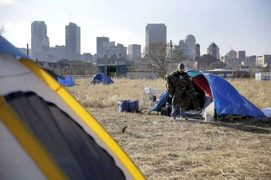 In this Tuesday, Jan. 27, 2015 file photo, Terry, cleans out his tent at a large homeless encampment, near downtown St. Louis. The gap between the haves and have-nots in the United States grew last year. Income inequality in the United States expanded from 2017 to 2018, with several heartland states among the leaders of the increase, even though several wealthy coastal states still had the most inequality overall, according to figures released Thursday, Sept. 26, 2019, by the U.S. Census Bureau. Photo: Jeff Roberson | AP File Photo