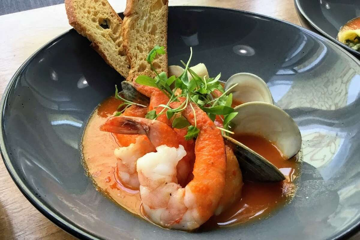 (British Airways continued): ... to the boutique lounge (for first-class members only), one of the standout dishes is a classic cioppino made with local seafood in a rich tomato broth with fennel and saffron.Access:British Airways customers flying on a scheduled flight in business or first class. Also, Silver and Gold Executive Club Members on scheduled flights operated by British Airways or oneworld partners. Additionally,Emerald and Sapphire level Members of any oneworld airline frequent flyer program can access the lounge if they are on a scheduled flight operated by British Airways or one of our oneworld partners. Fun fact:You can access the gate directly through the lounge.Find them:International Terminal A, boarding area A near Gates A4 and A6