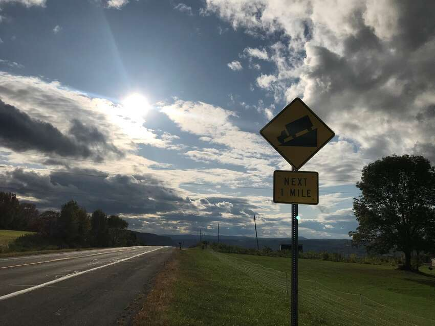 A sign on Route 30A warning drivers about the steep incline is seen on a recent day in September 2019. There are many signs warning trucks against taking the route after it crosses Route 7 and descends to end at Route 30 in the Town of Schoharie. About a mile and a half from this sign is the intersection where a limo carrying 17 passengers and a driver blew through a stop sign Oct. 6, 2018 and crashed into an earthen embankment, killing all aboard as well as two people in the adjacent parking lot of the Apple Barrel Country Store and Cafe.